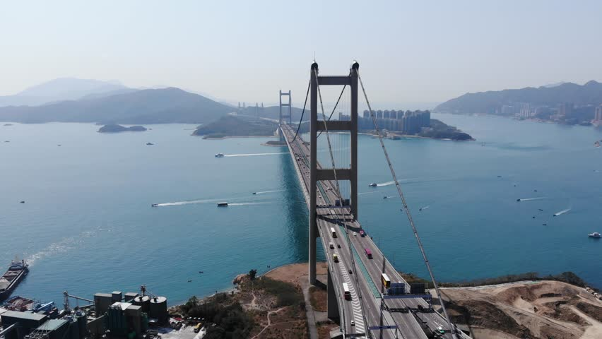 View of large Tsing Ma suspension bridge spanning across Ma Wan channel, looking from Tsing Yi island. Famous Lantau Link highway in direction to Hong Kong International Airport