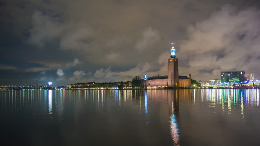 4K Time Lapse of Stockholm City Hall building at night. Town Hall famous landmark, nobel prize award ceremony. Beautiful water reflections, Capital city of Sweden