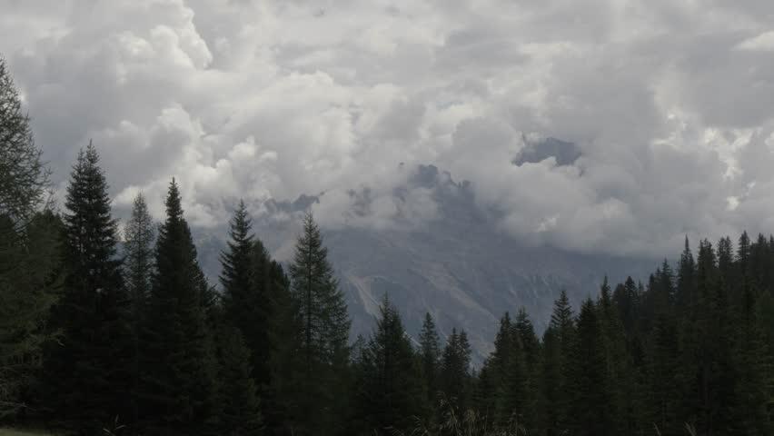 View of cloud surrounding mountain range from Passo Falzargo, Cortina d'Ampezzo, Belluno, Dolomites, Italy, Europe