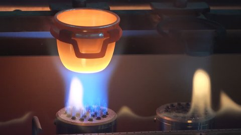 Hot metal melt in crucible on fire