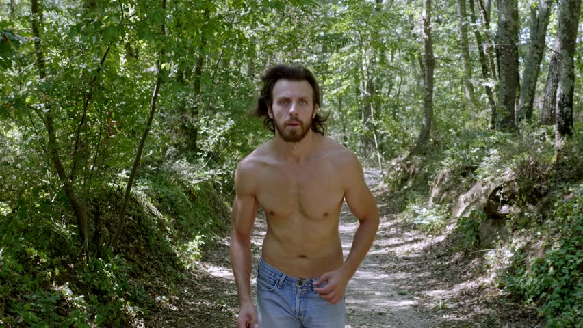 into the wild: attractive man running in the wood. Nature,exercise, tranquillity #1013849774