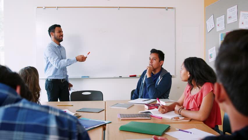 Male High School Pupil Writing On Whiteboard In Maths Class | Shutterstock HD Video #1013866994