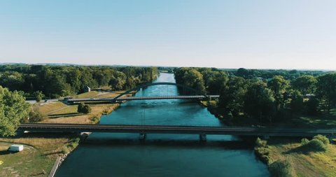 Drone Shot of a River with Bridges and a huge Wave