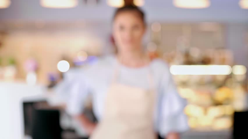Portrait of female barista at cafe