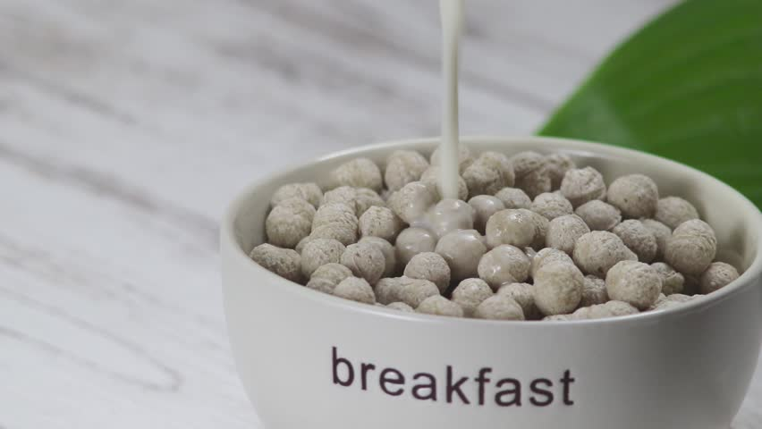 healthy Breakfast on the table. crispy balls with milk