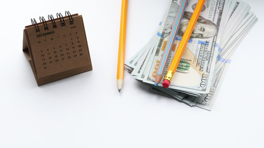 Concept for financial timing and bills date, money, calendar and place for text | Shutterstock HD Video #1013925314