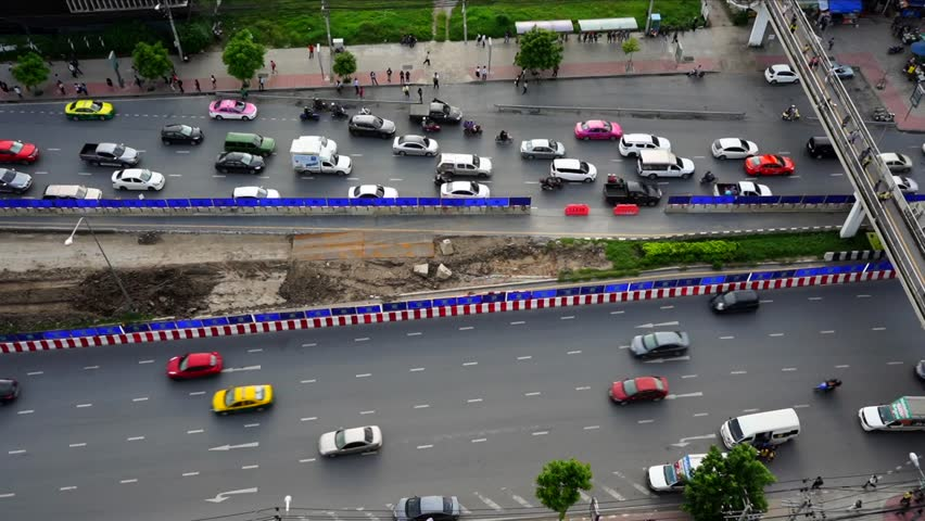 FHD Timelapse,Aerial top down view of traffic jam on a car road with train construction and people waiting at bus station,some people walking on bridge over the road. #1013926934