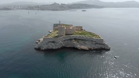 Aerial of Château d'If, famous island of Count of Monte Cristo in southeastern France. Flying over French island in the Frioul archipelago in Mediterranean. Historical fortress and prison in France.
