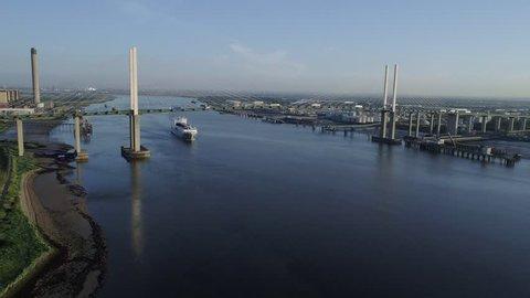 Drone descends towards ro-ro cargo ship Adeline as it passes under Queen Elizabeth II Bridge