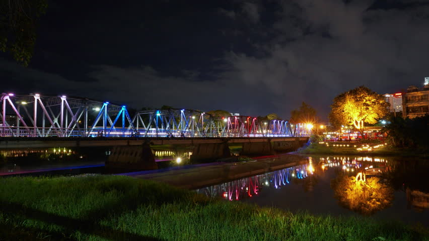 Time lapse Iron Bridge or people in the area called Sapaan Lek. Decorated with colorful lights at night. The landmark of Chiang Mai in northern Thailand is very famous.