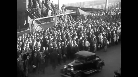 CIRCA 1930s - Workers stream into the General Motors automobile factory in the 1930's as whole towns spring up around the car industry in Michigan.