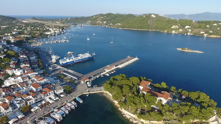 SKIATHOS, GREECE, SEPTEMBER 2016: Aerial view of the port in Skiathos, Greece. Drone view of Skiathos old town and marina during sunny summer day.