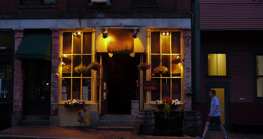 An evening establishing shot of a New England city's bar or restaurant.  	 | Shutterstock HD Video #1014004454
