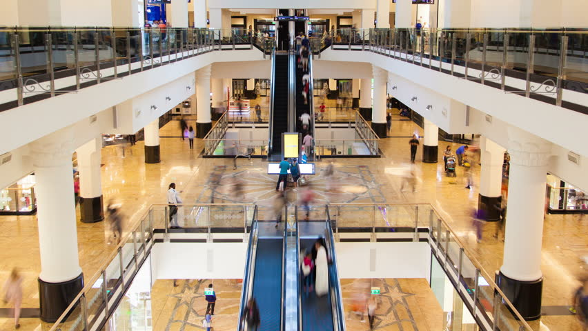 Shopping Mall fast flow of people on escalators time-lapse #1014045704