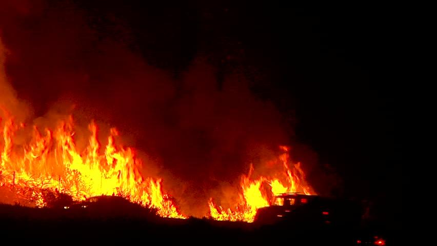 2017 - the Thomas Fire burns at night in the grass above the 101 freeway near Ventura and Santa Barbara, California. | Shutterstock HD Video #1014058484