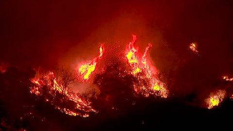 2017 - the Thomas Fire burns in the hills above the 101 freeway near Ventura and Santa Barbara, California.