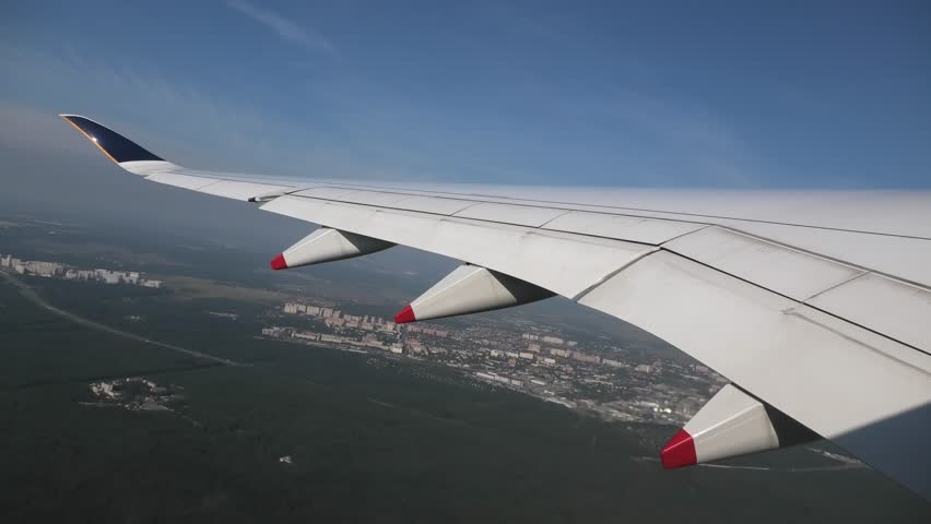 Window seat view of wing while taking off from Moscow Domodedovo Airport in Russia.