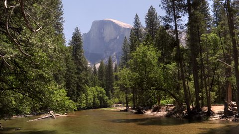 a summer view of half dome and merced river in yosemite national park in the united states