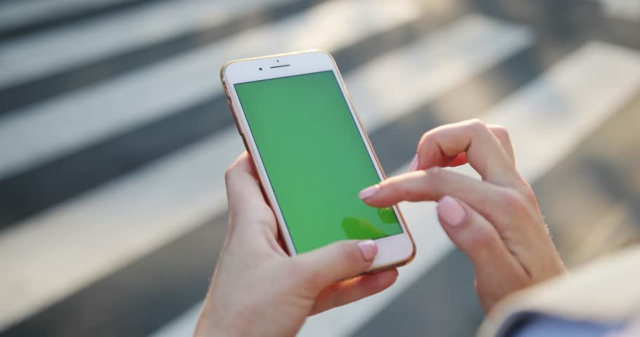 PARIS, FRANCE- APRIL 05, 2017: hand woman young holding using smart phone with vertical green screen background crosswalk modern tapping display new technology outdoor message slow motion | Shutterstock HD Video #1014104414