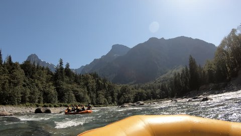 Point-of-view camera in UHD captures the exhilarating experience of rafting the Skykomish River on a summer day.  The River's headwaters start in the Cascade Mountains of Washington State, USA.