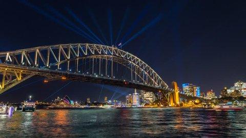 Sydney Harbour Bridge during Vivid Sydney Festival - timelapse video of the Spectacular light show and reflection around the Sydney Harbour Bridge and CBD of Sydney