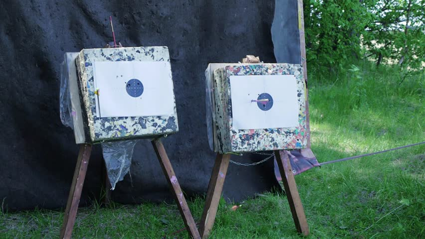 Arrow hits the target. Clip. Bow Arrows hitting a bullseye target at archery bow