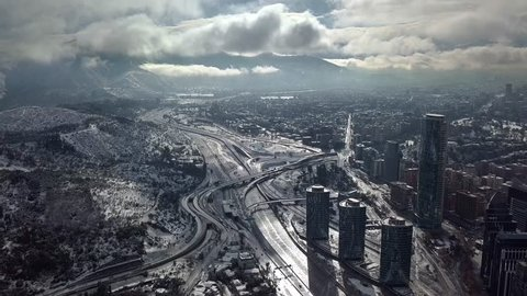 "Aerial view of ""Manquehue hill"" and ""Vitacura bicentennial park"" of Santiago of Chile after the historical snowfall occurred in June of 2017"