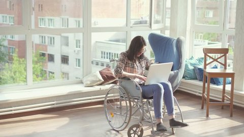 Young woman disabled by a business employee in a wheelchair.
