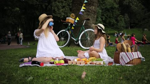woman take photo on polaroid girl pose smiling resting in park have picnic drink tree love girl summer nature beautiful emotive outdoors outing pleasure positive pretty relations slow motion