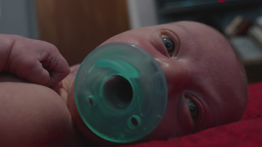 This is a shot of a newborn baby sucking on his pacifier. Shot on a GH5