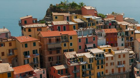 Telephoto close-up shot of the village of Manarola in Cinque Terre, Liguria, Italy, a UNESCO World Heritage Site, famous for its coastline, five villages and surrounding hillsides