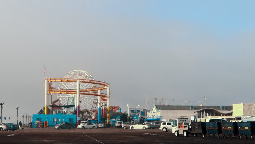 A garbage truck loses its bins on the Santa Monica Pier.