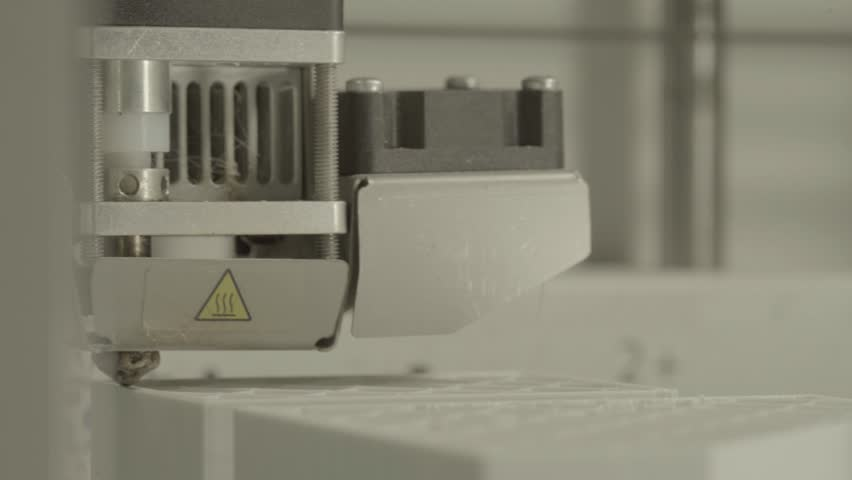 Printing a 3D printer while working. Close-up.