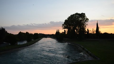 River Mincio, Veneto, Italy at sunset flowing towards Mantova.