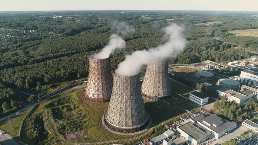 Aerial view on the working Power station. Cooling tower of nuclear power plant. coal-burning power plant | Shutterstock HD Video #1014427274