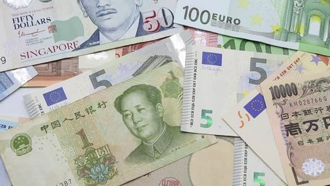 put Japanese banknote, Euro Banknote and Chinese banknote on international banknotes and ending by focus on Chinese Banknote.