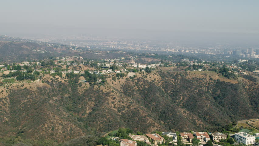 Aerial view of the Brentwood area of Los Angeles, California during the day. Shot with a RED camera. 4k footage.