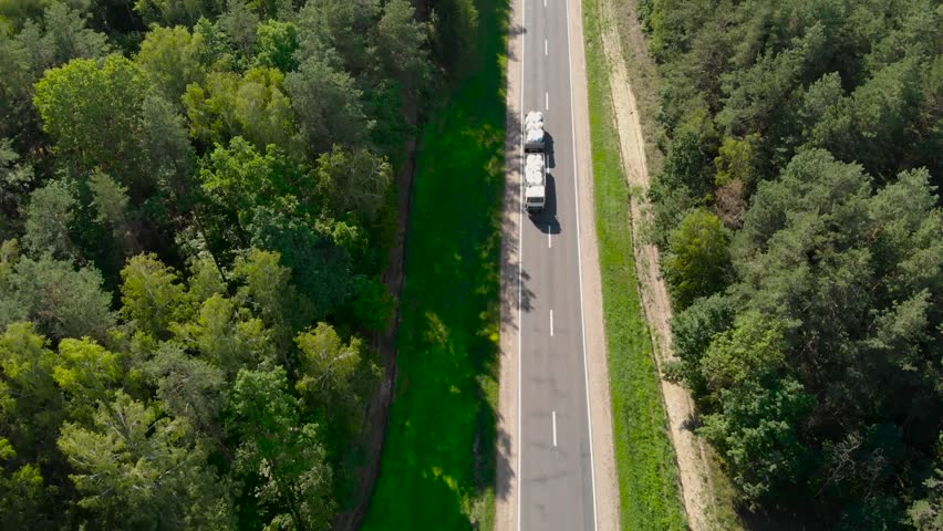 Aerial View Flying Over Two Lane Forest Road With Cars Moving #1014449624