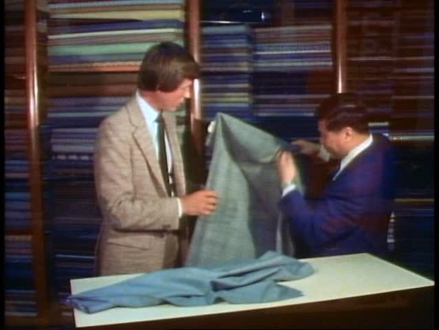 HONG KONG, CHINA, 1982, Hong Kong tailor, customer buying a custom tailored suit