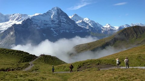 Hiker at Grindelwald-First with Eiger and Jungfrau, Bernese Alps, Switzerland, Europe
