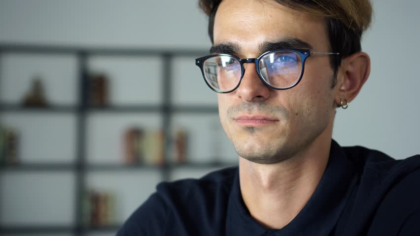 Portrait of succcessful young man working and looking in the Monitor, Computer Screen Reflects in His Glasses | Shutterstock HD Video #1014534734