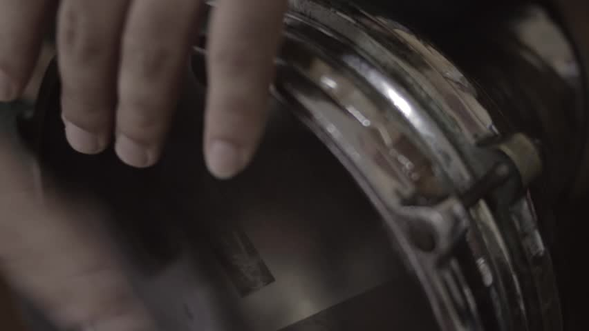 Close up shot of a man playing darbuka, in slow motion