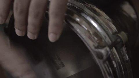 Close up shot of a man playing darbuka, in slow motion