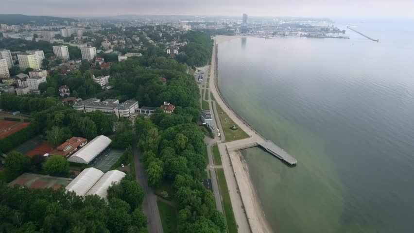 4K. Aerial view. The city of Gdynia-Poland on the beach. Sunny morning.  City is located on the shore of the Baltic Sea.