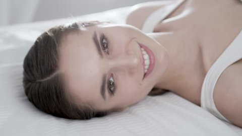 Face Care. Young Woman Lying On Bed And Touching Skin On Face