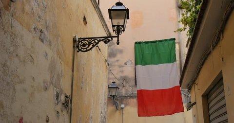 Italian Flag on narrow street, Sorrento, Costiera Amalfitana (Amalfi Coast), UNESCO World Heritage Site, Campania, Italy, Europe