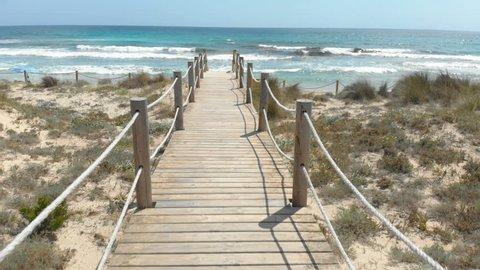 Wooden Jetty on a Mediterranean Beach in Menorca, Spain in Summer