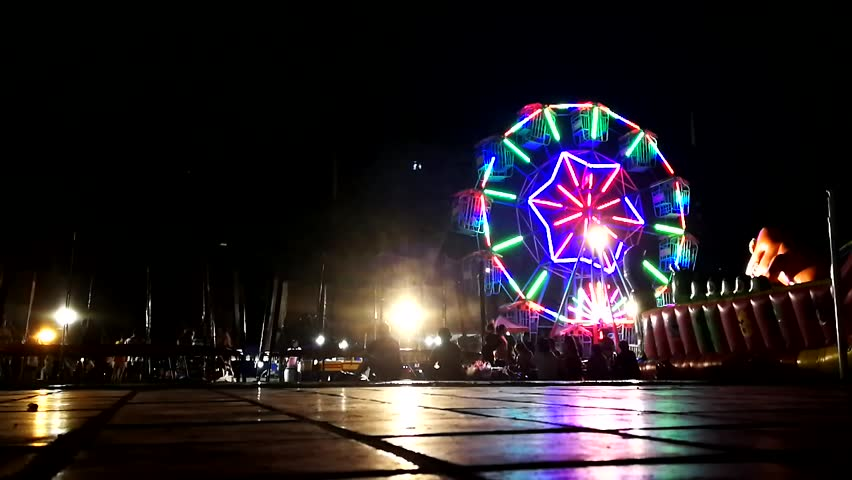 Ferris wheel and people at the fair.