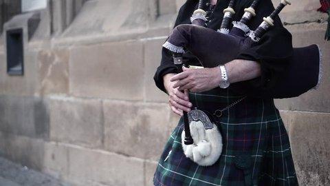 street artist - Scottish piper in Highland national dress