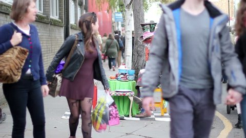 London, England - October 30 2017: Actor in the role of the mad hatter waits for tourists. Portobello Road